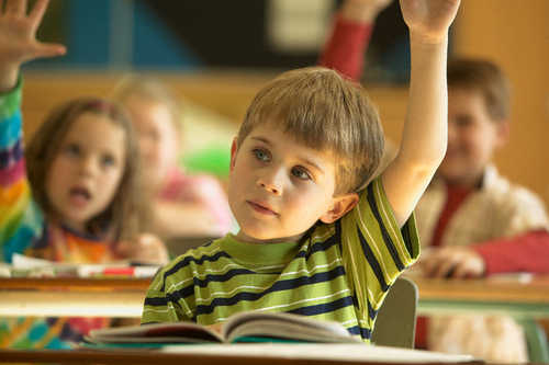 Students with Raised Arms in Classroom